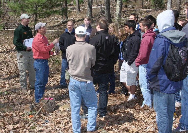 High school youth participating in Deer and Forest Ecology field activity