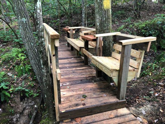 Mark added seating to his footbridge project to create a quiet, comfortable place to enjoy the view.