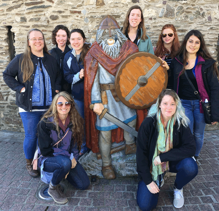 The class in Waterford, Ireland. standing, L-R: Caitlin Rauch, Anne McGraw, Kylie Hint, Melissa Miller, Hanna Albright, and Nicole Rella. Kneeling (L) chaperone Mara Cloutier and (R) student Bethany Thatcher. Dr. Drohan took the picture.